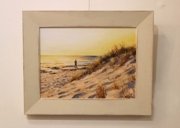 A framed oil painting depicting the late afternoon sun on a beach in Perth Western Australia