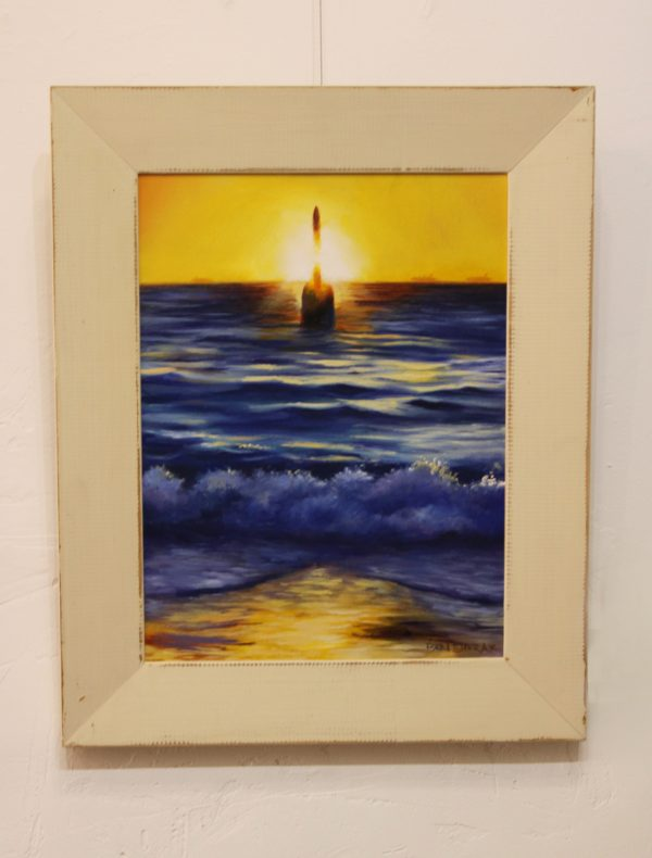 A framed original oil painting depicting a sunset at Perths popular Cottesloe beach