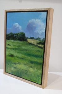 A small painting of a winter field on a sunny day in Western Australia's southwest