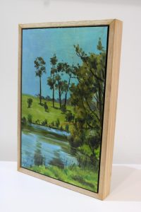A painting of a field and lake on a farm in Western Australia's southwest