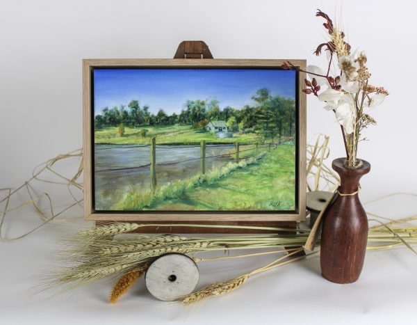 A painting of a farmhouse in the distance with a lake and fence in the foreground showing a traditional scene from Western Australias Margaret River region