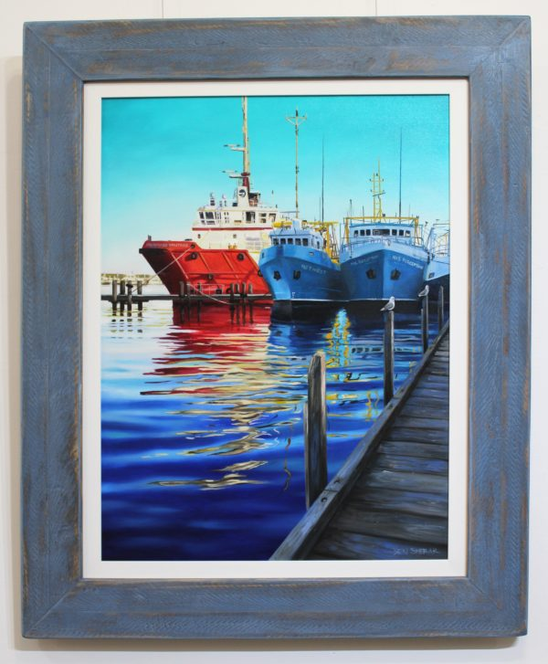 An original painting by Western Australian Artist Ben Sherar depicting brightly coloured fishing trawlers in a harbour